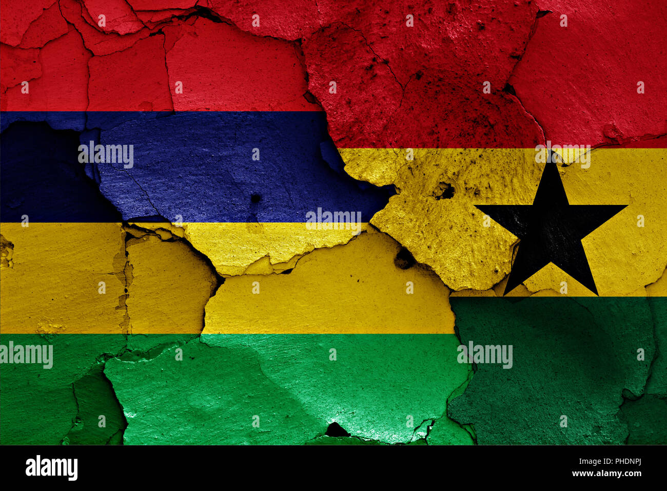 flags of Mauritius and Ghana painted on cracked wall - Stock Image
