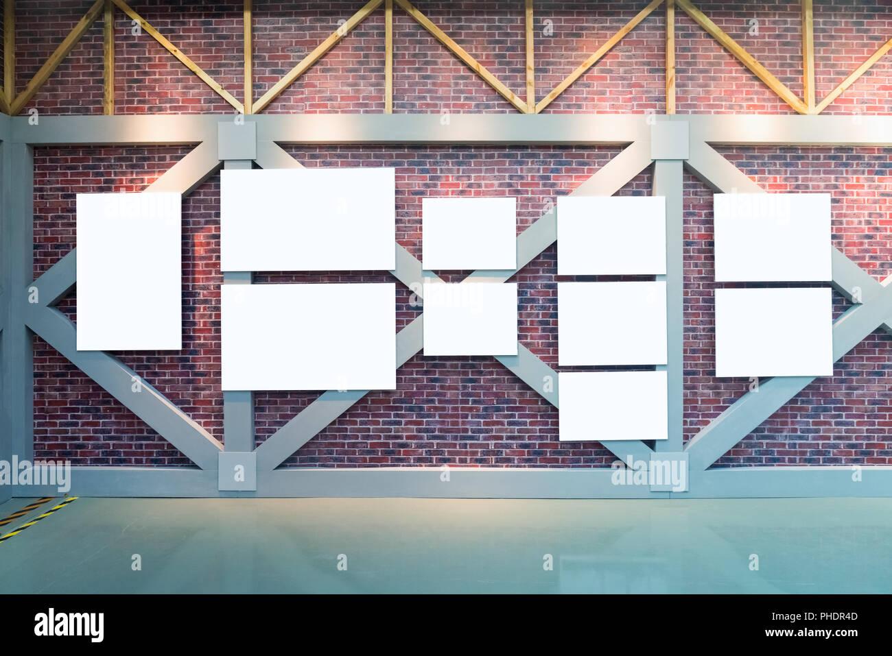 blank frames on brick wall - Stock Image
