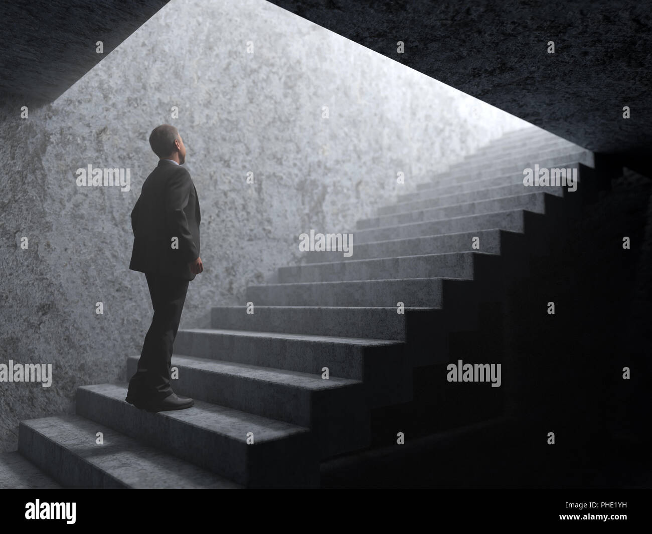 man climbs the stairs from darkness to light - Stock Image