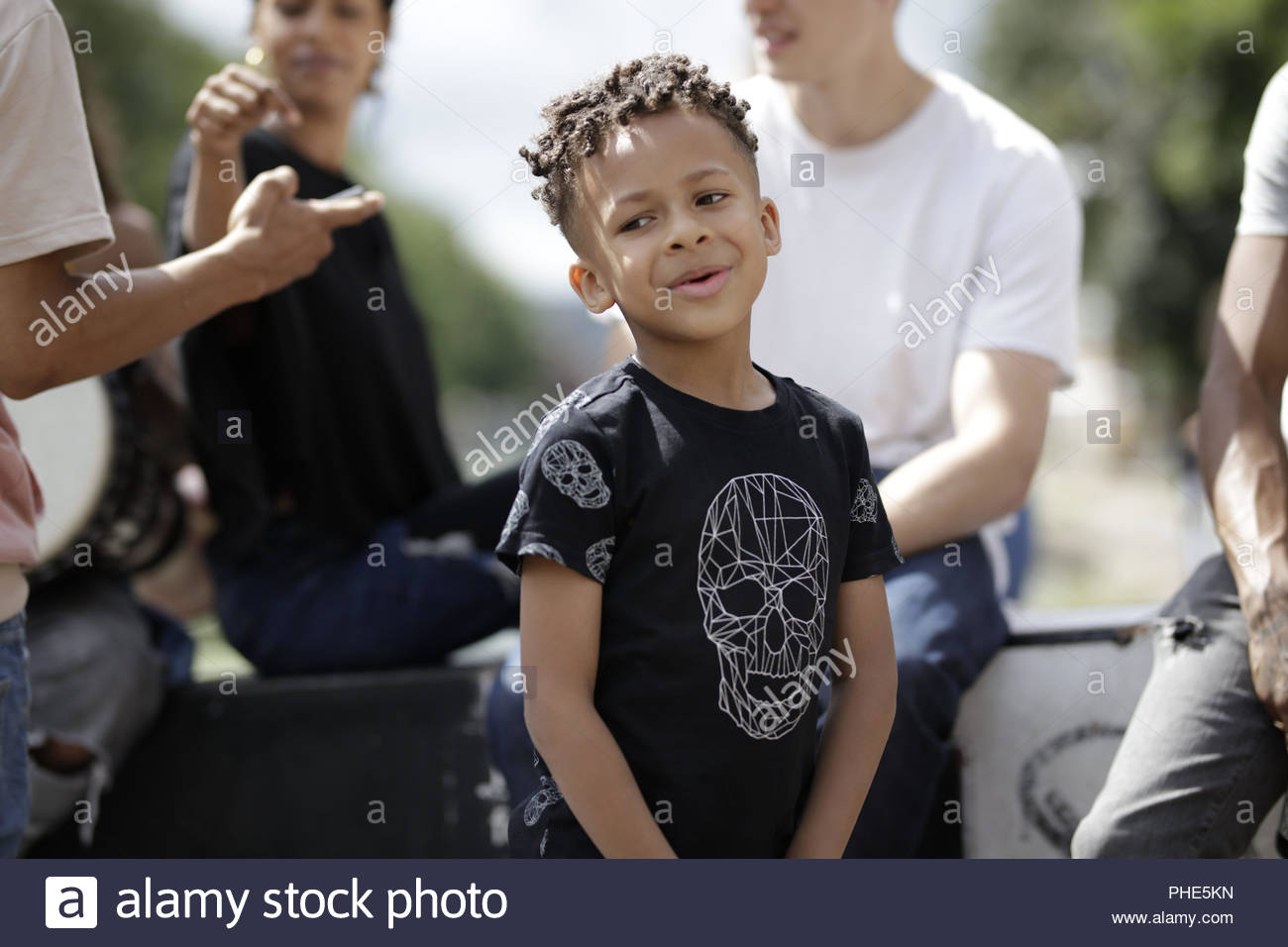 Boy spending time with family in park - Stock Image