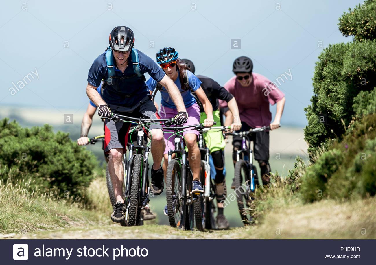 Group of people mountain biking in Somerset, England - Stock Image