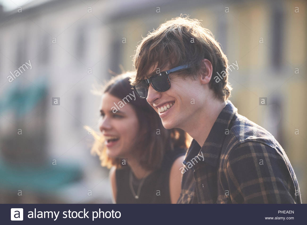 Teenage couple smiling - Stock Image
