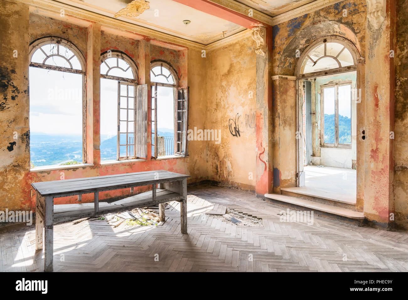 Spooky interior of abandoned ruined house Stock Photo