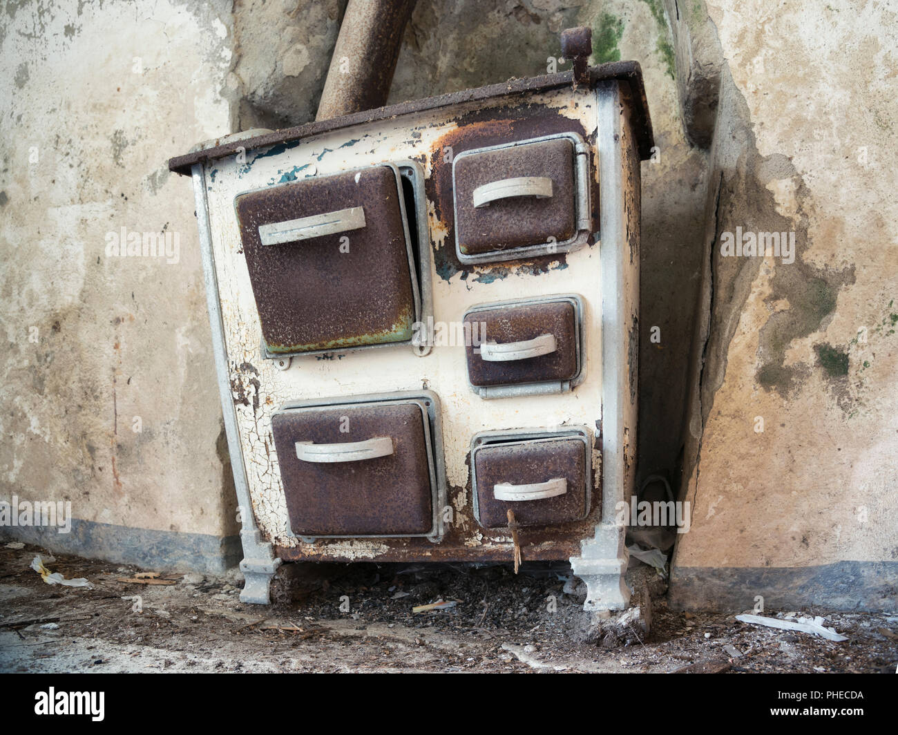 old stove in abandoned rural farm - Stock Image