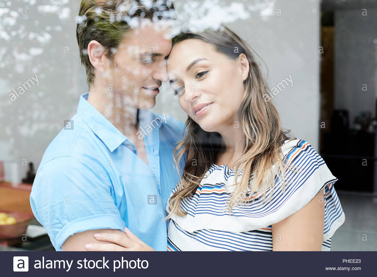 Young couple behind window in Ko Samui, Thailand - Stock Image