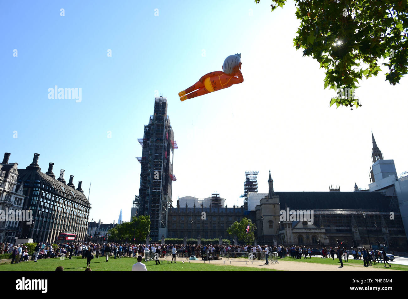 An inflated blimp of London mayor Sadiq Khan depicted in a bikini flies over Parliament Square, Westminster in London, as part of a campaign seeking to remove Mr Khan from his post. - Stock Image