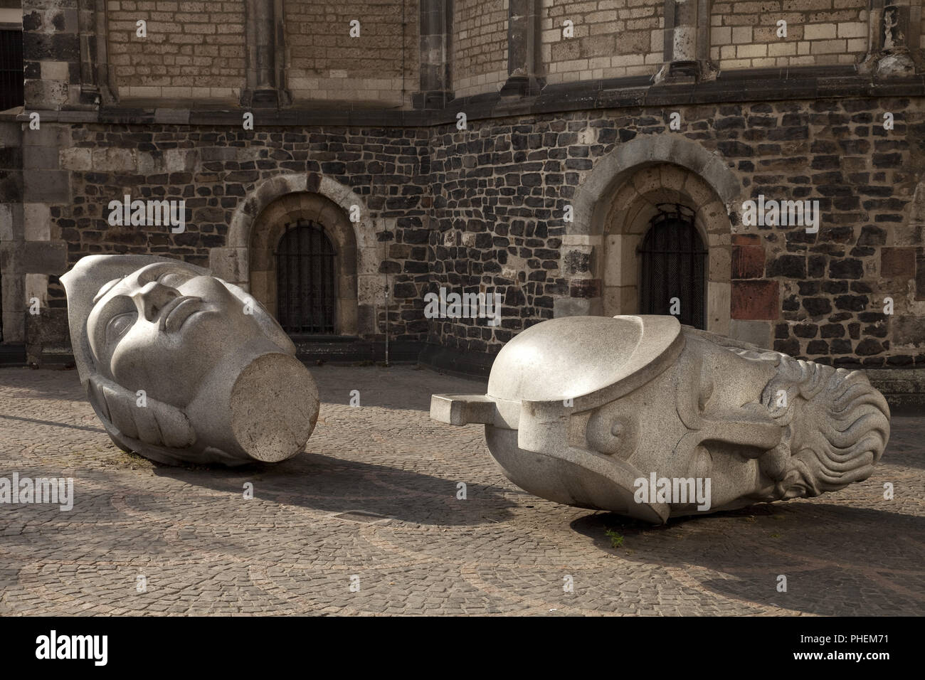 Cassius and Florentinus, two granite heads in front of Bonn Minster, Bonn, Germany, Europe - Stock Image