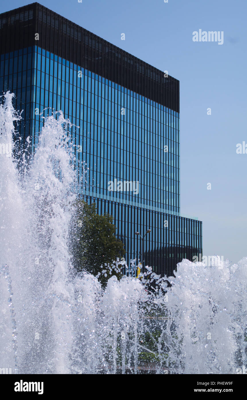 Office building behind a fountain, Katowice, Poland. - Stock Image