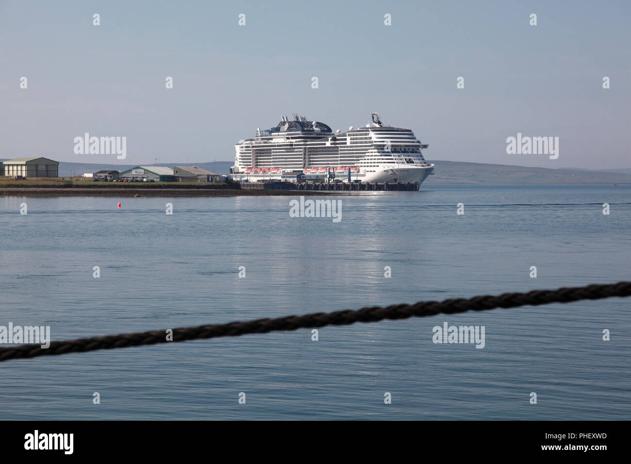 The cruise liner MSC Meraviglia with up to 5,000 passengers moored in a deep water berth on the outskirts of Kirkwall, Orkney - Stock Image
