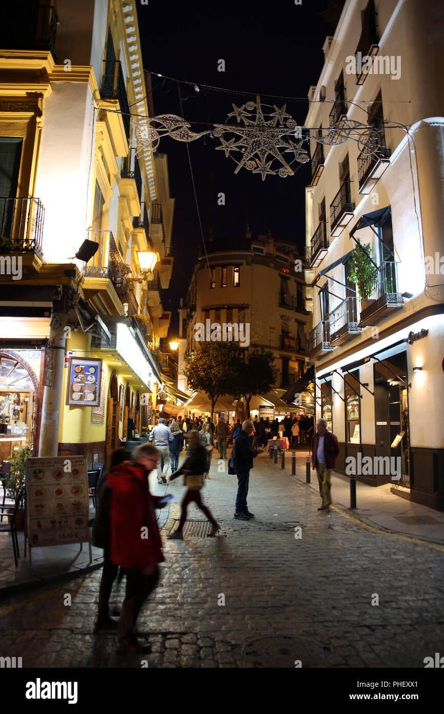 Passers-by in a street of the historic old town - Stock Image