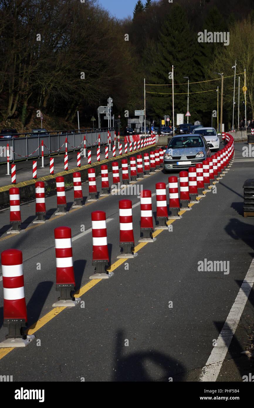 Single-lane traffic guidance over a repairable bridge - Stock Image