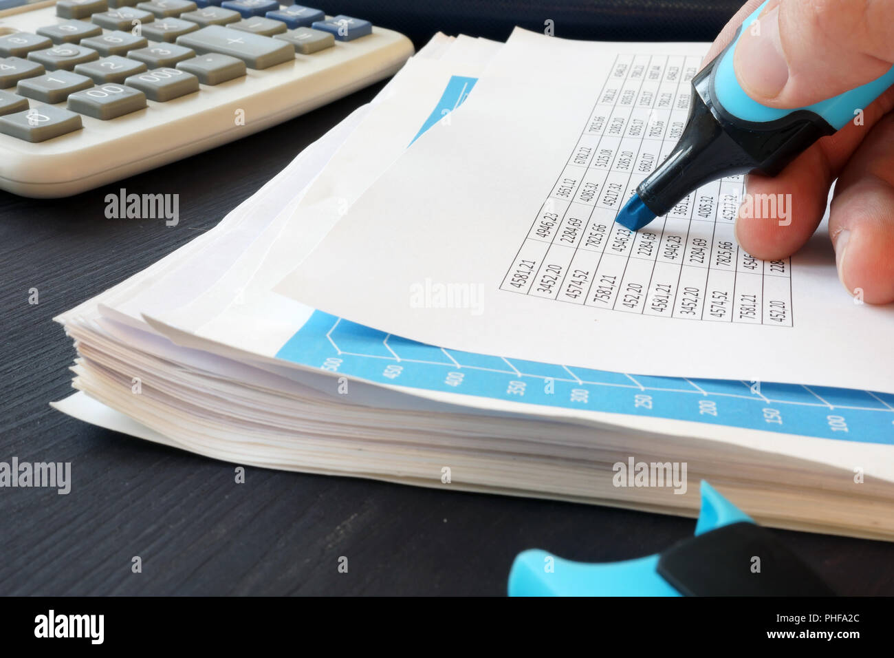 Auditor is checking financial report by marker. - Stock Image