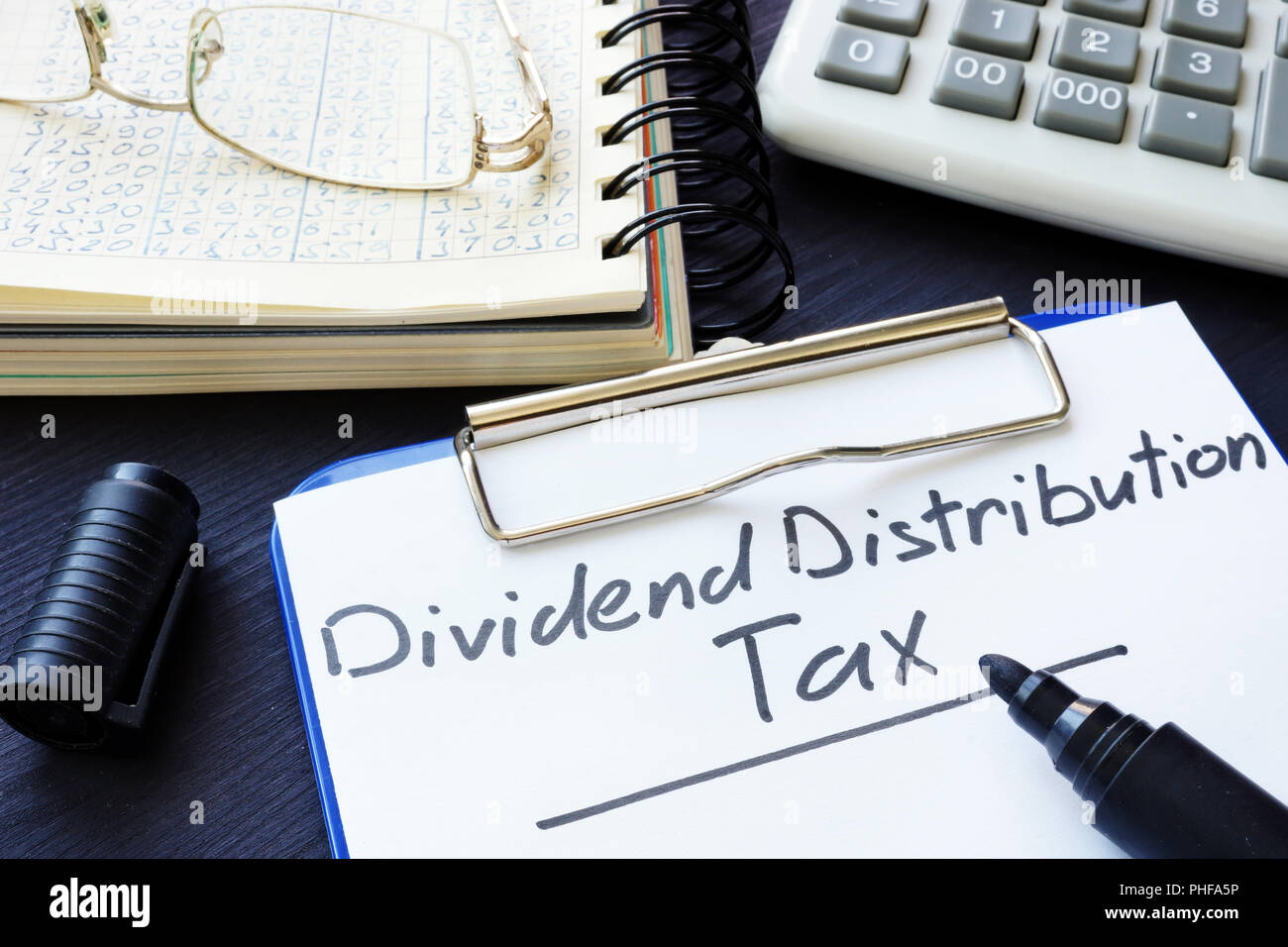 Dividend Distribution Tax DDT written on a sheet of paper. - Stock Image