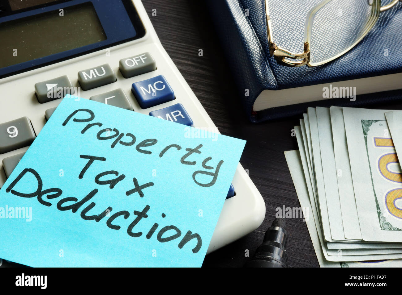 Property tax deduction written on a label. - Stock Image