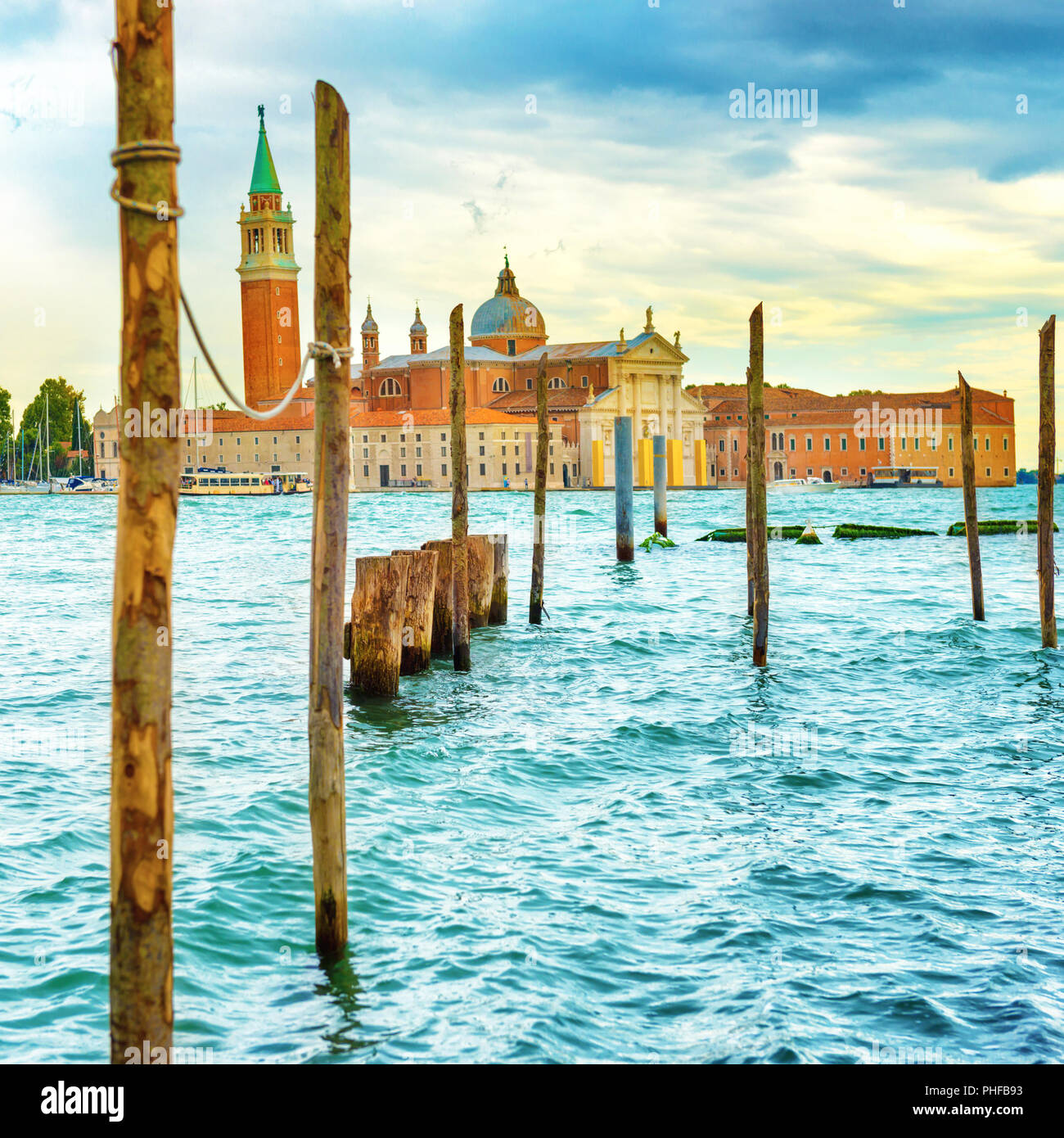 Moorage for gondolas with wooden poles - Stock Image