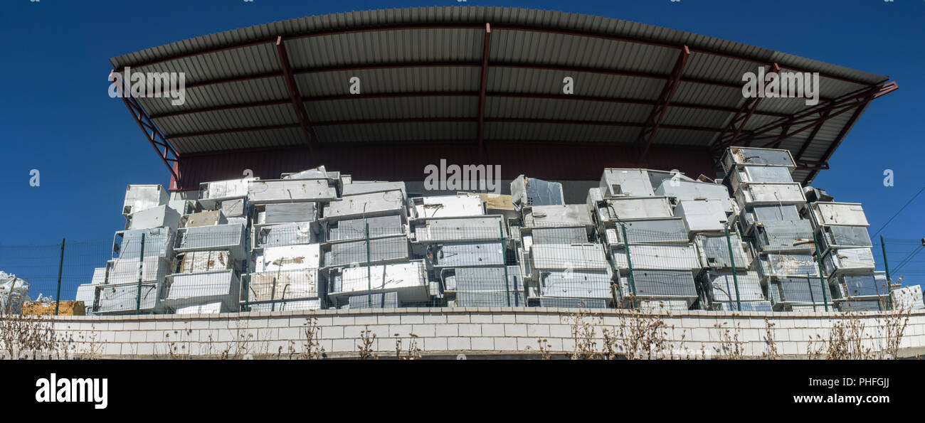 Huge piles of refrigerators stacked at recycling plant. Panoramic - Stock Image