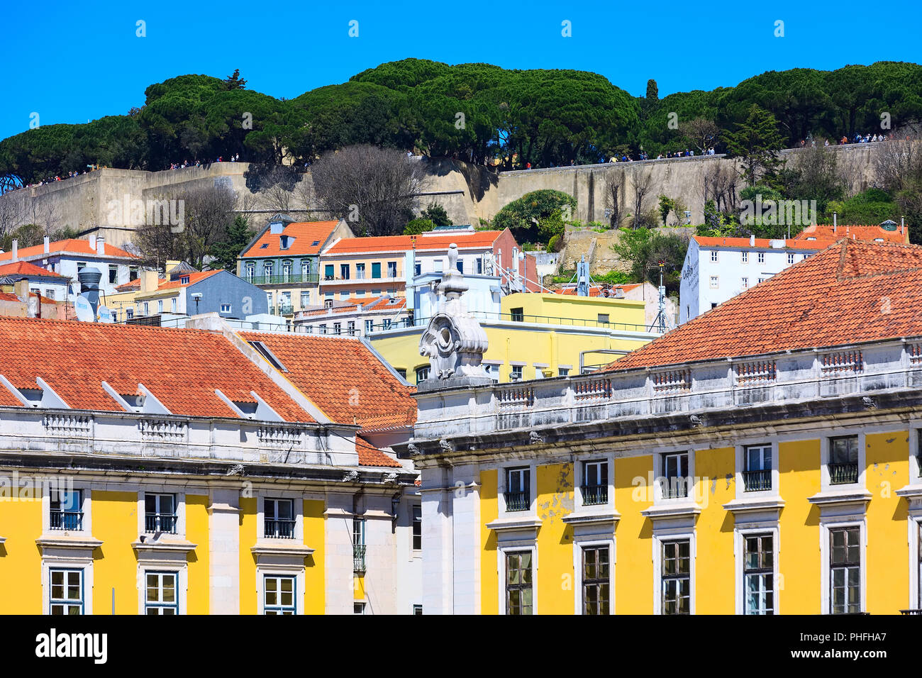 Lisbon, Portugal landmark, square of commerce, houses and Saint George Castle on the hill - Stock Image