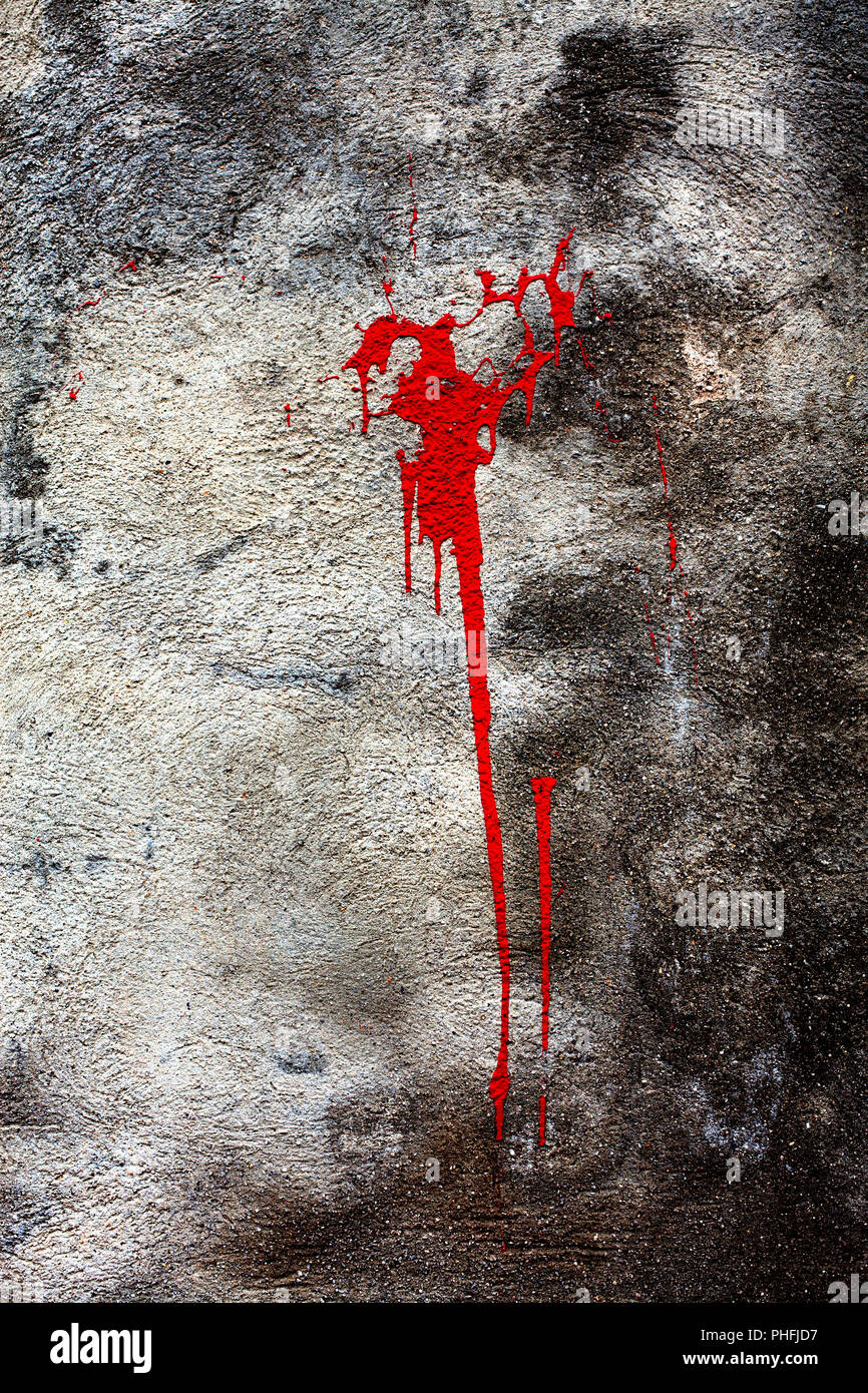 Splattered red paint on wall. - Stock Image