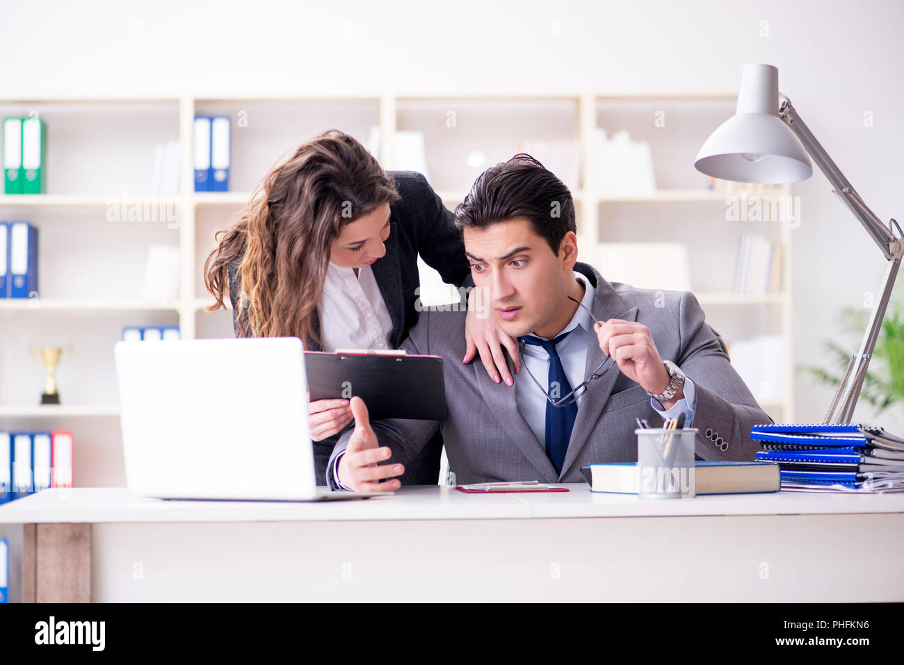 Unhappy boss having a chat with his secretary Stock Photo