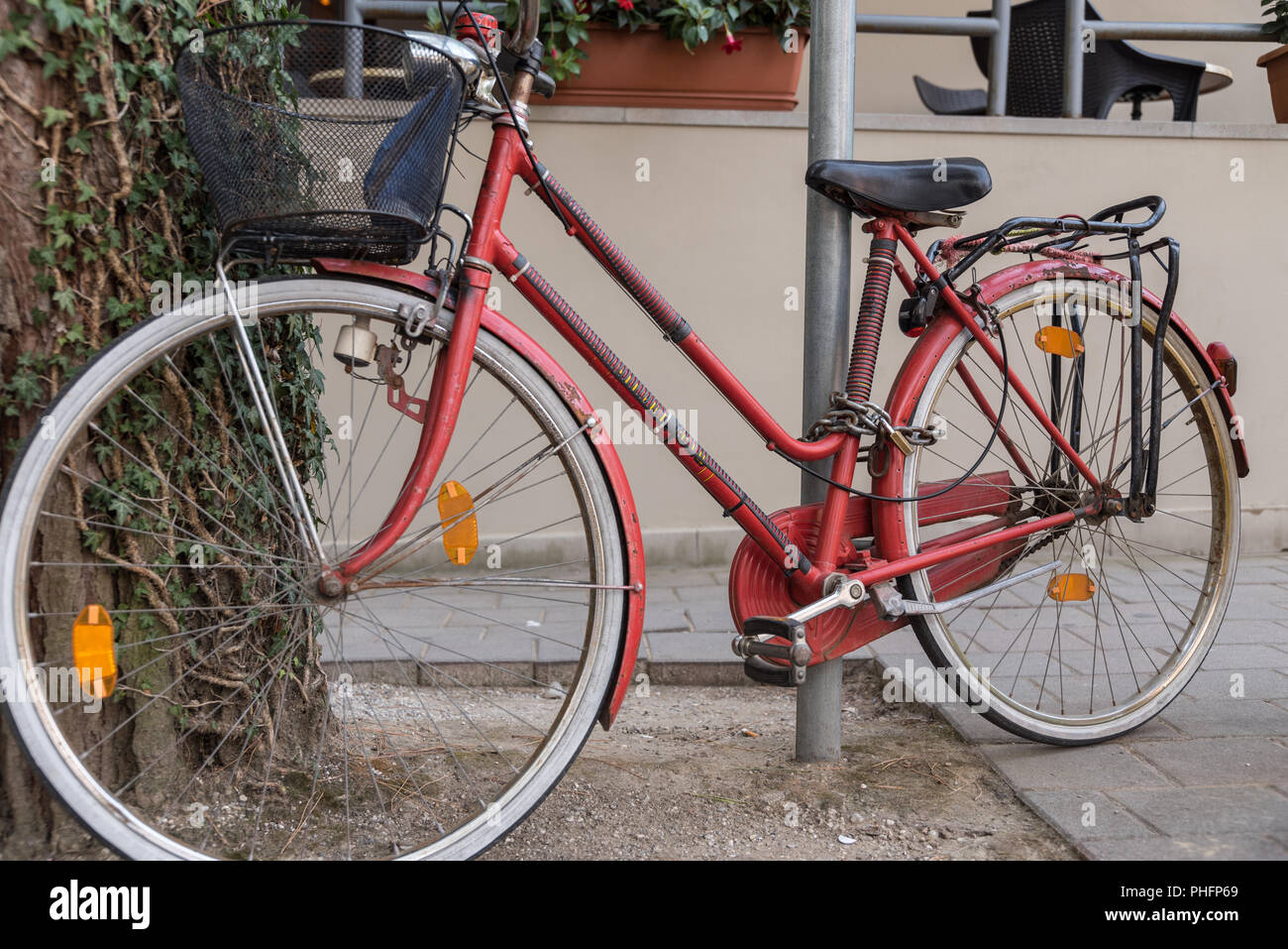 Bicycle locked and parked theft proof - Stock Image