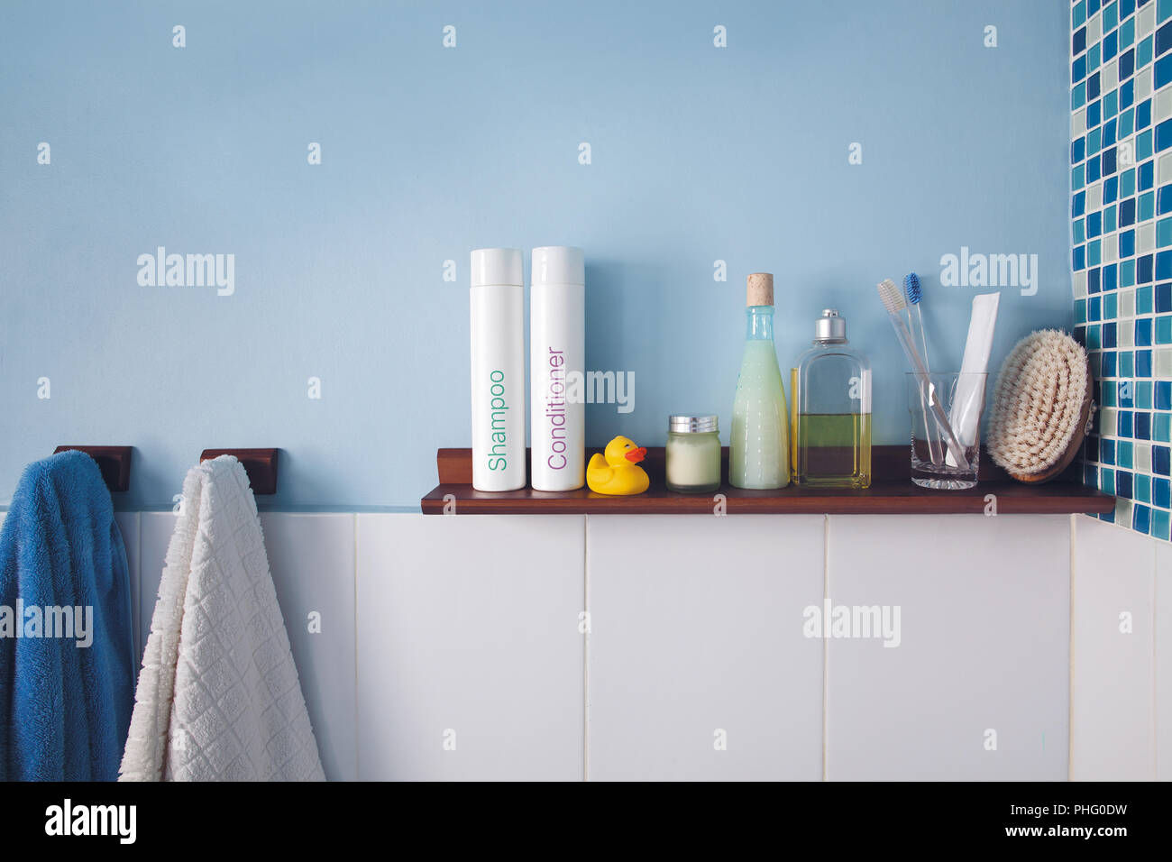 Blue wall and a shelf in the bathroom with hygiene accessories Stock ...