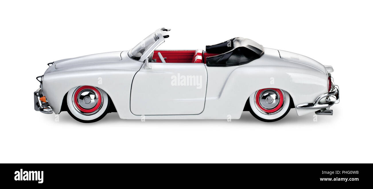 White vintage cabriolet model on a white background - Stock Image