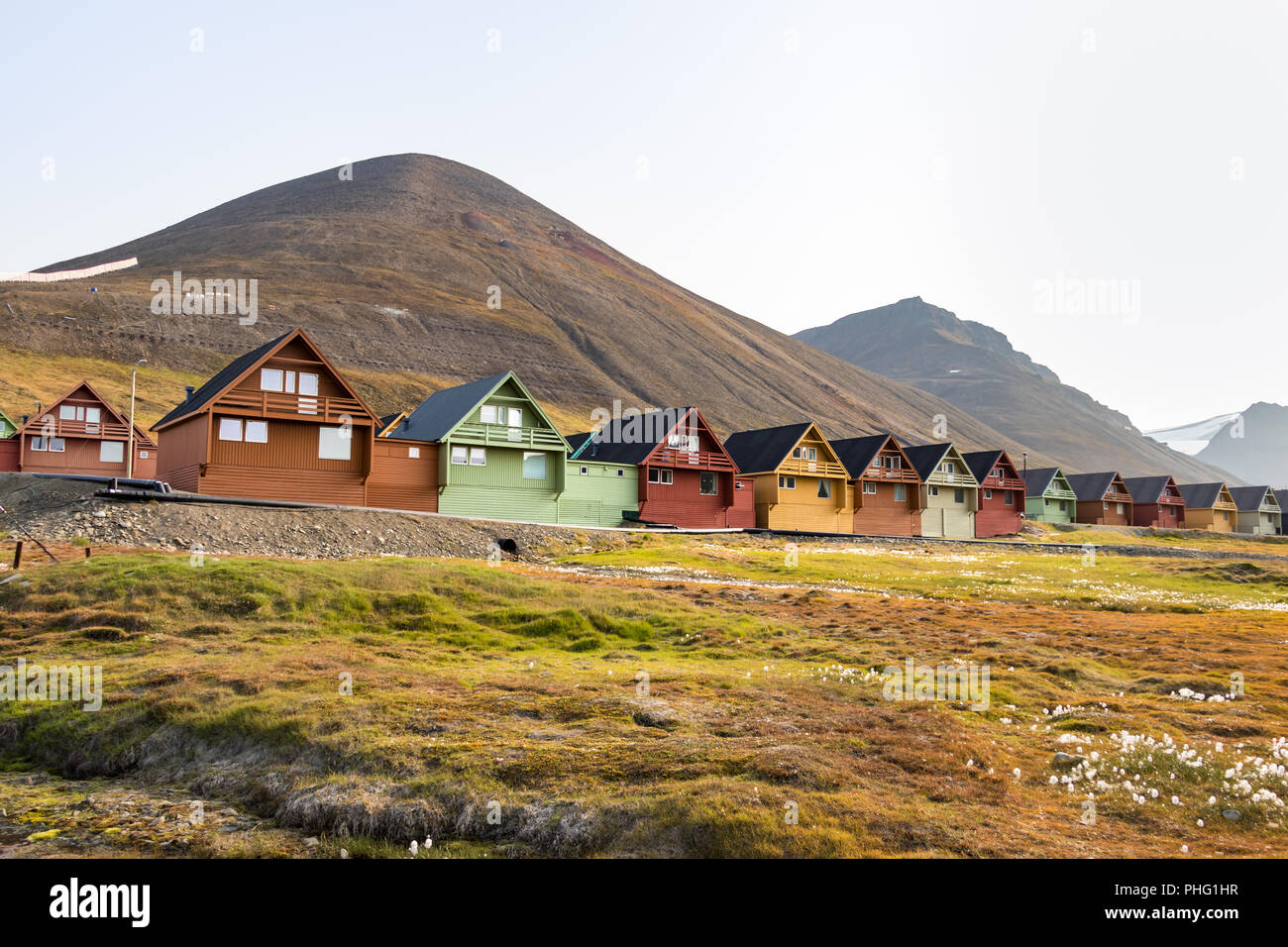 Colorful wooden houses along the road in summer, Longyearbyen, Svalbard, Norway. - Stock Image
