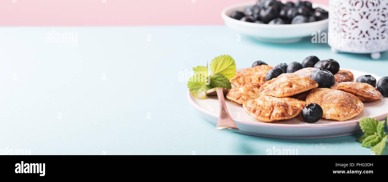 Dutch mini pancakes - Stock Image
