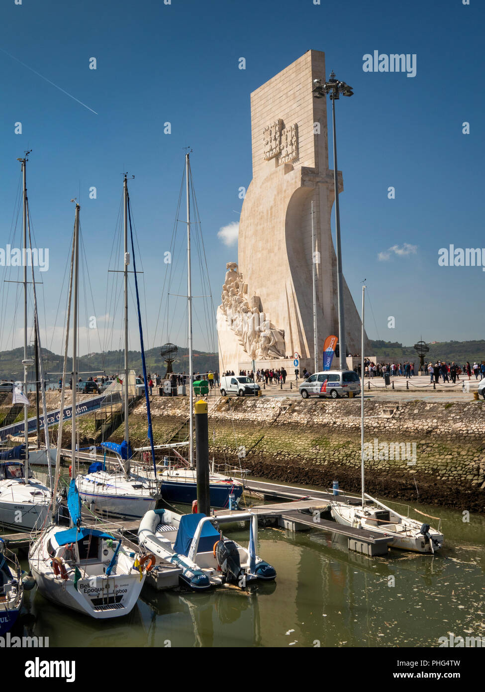 Portugal, Lisbon, Belem, Padrao dos Deccobrimentos, the discoveries monument, behind boats moored in marina - Stock Image