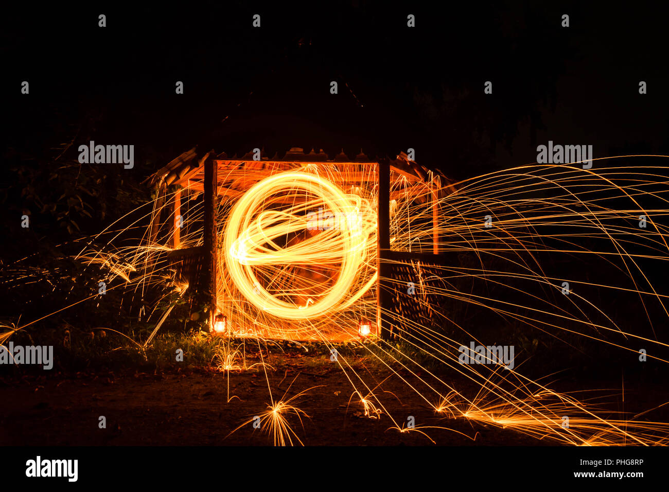Long exposure image of steel wool photography, light painting in wooden house. Stock Photo