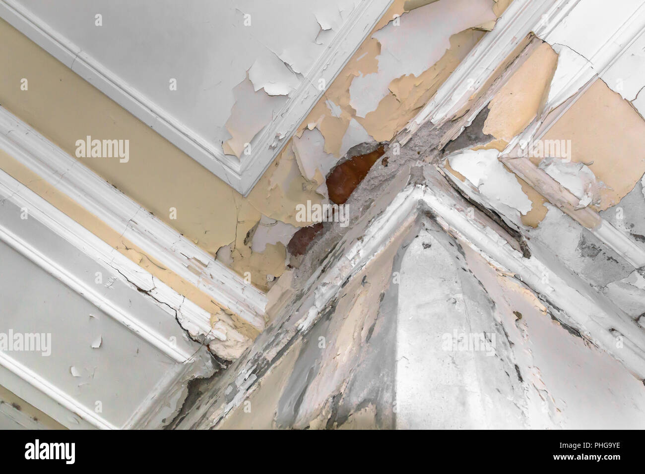 Ceiling and walls damage by humidity - Stock Image