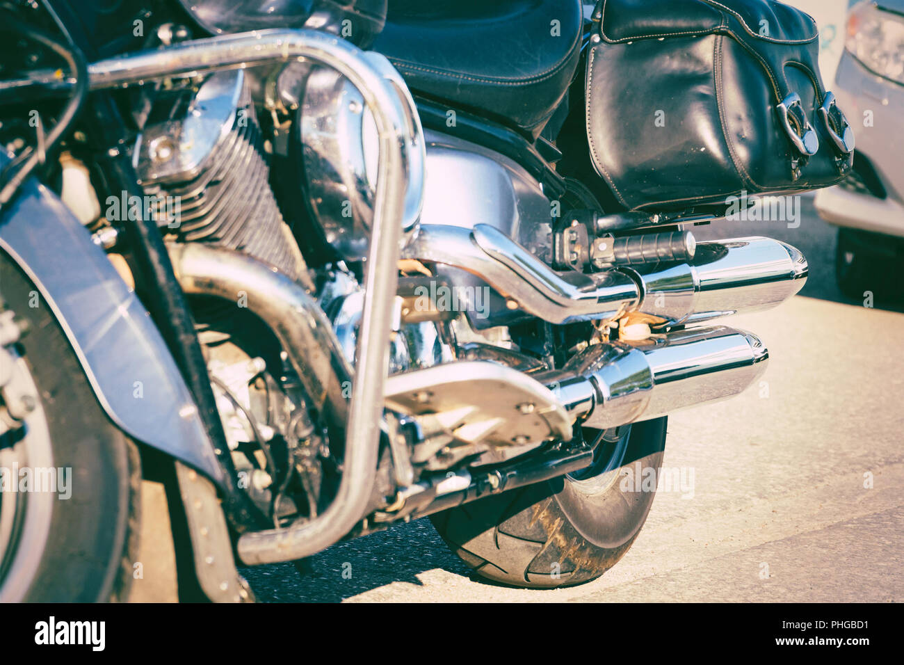 Black leather bag on a black powerful motorcycle - Stock Image