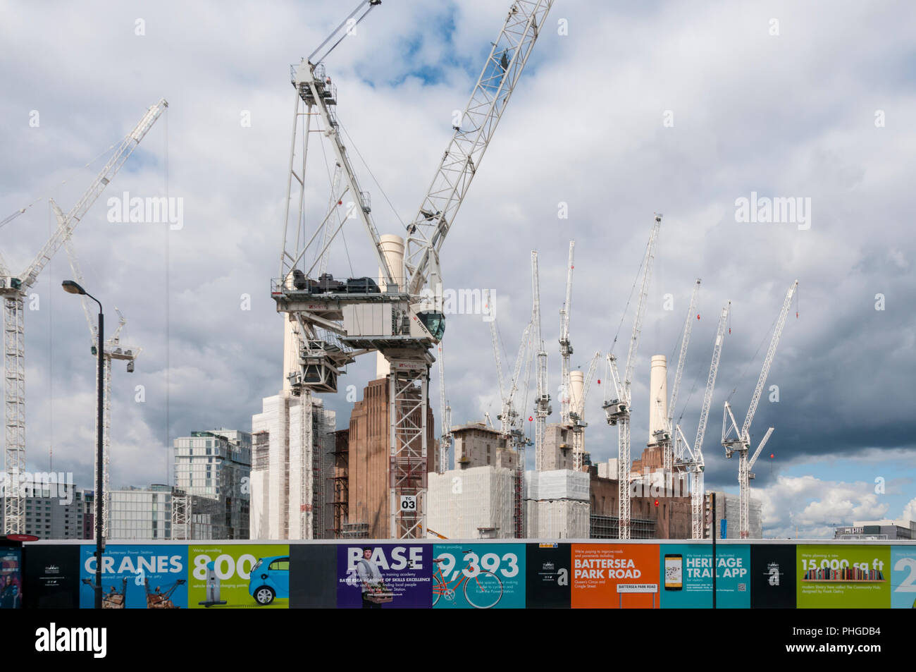 Tower cranes around the iconic chimneys of the closed Battersea Power Station, now a major re-development site. - Stock Image