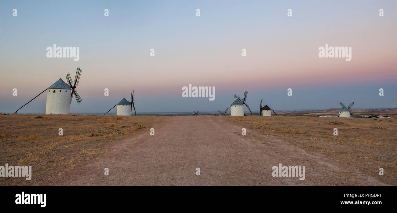 Traditional windmills at rising, Campo de Criptana, La Mancha, Spain. Panoramic - Stock Image