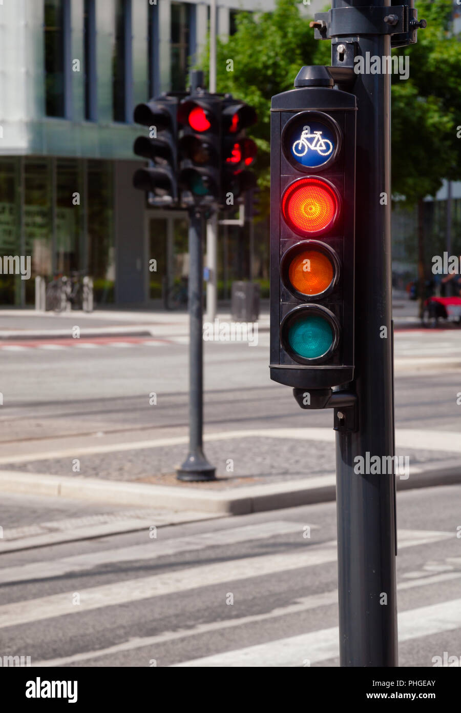 Red signal on traffic light prohibits any traffic on a cycle route in Southern Norway - Stock Image