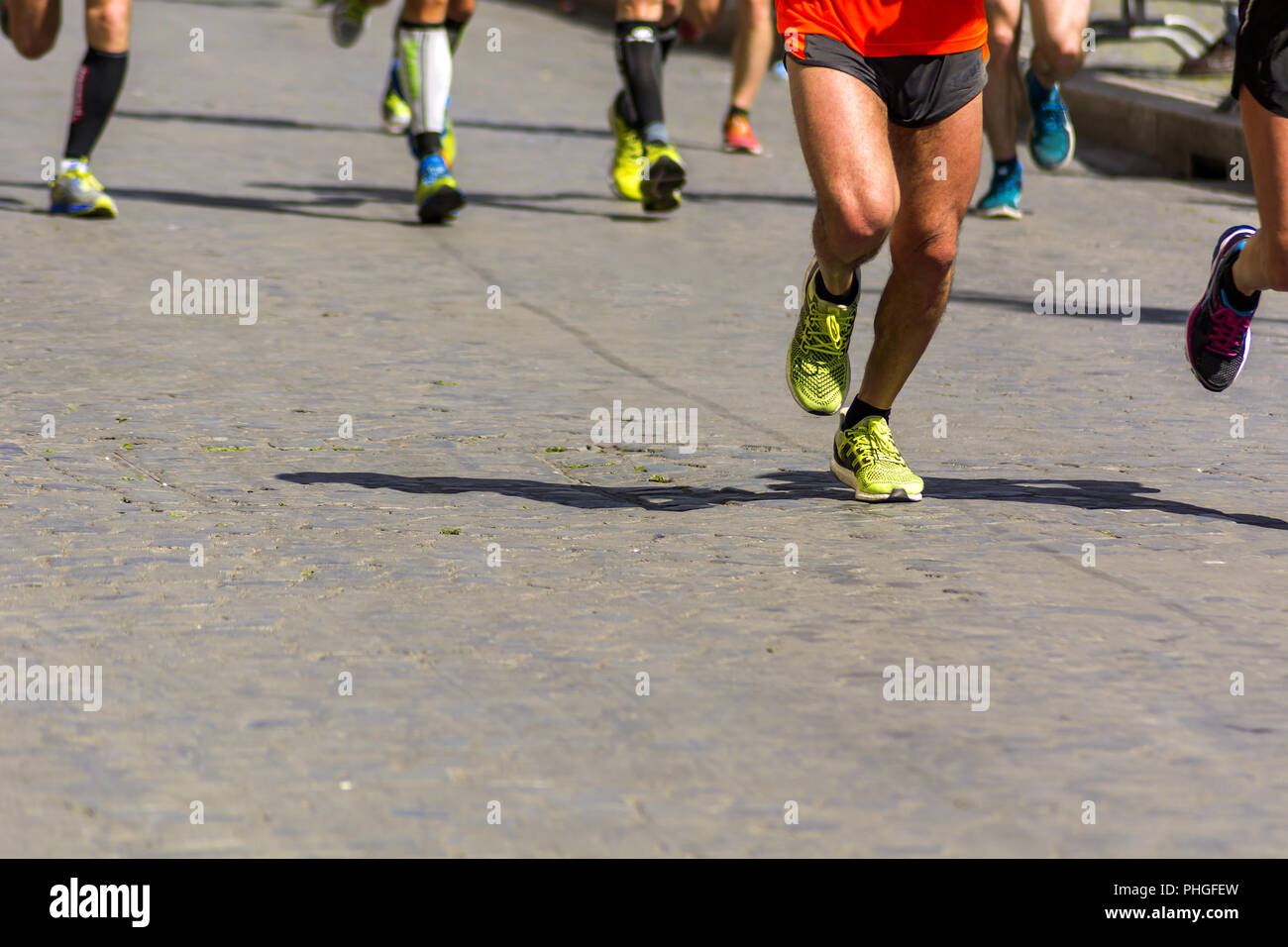 Detail of a group of runners during a city marathon - Stock Image