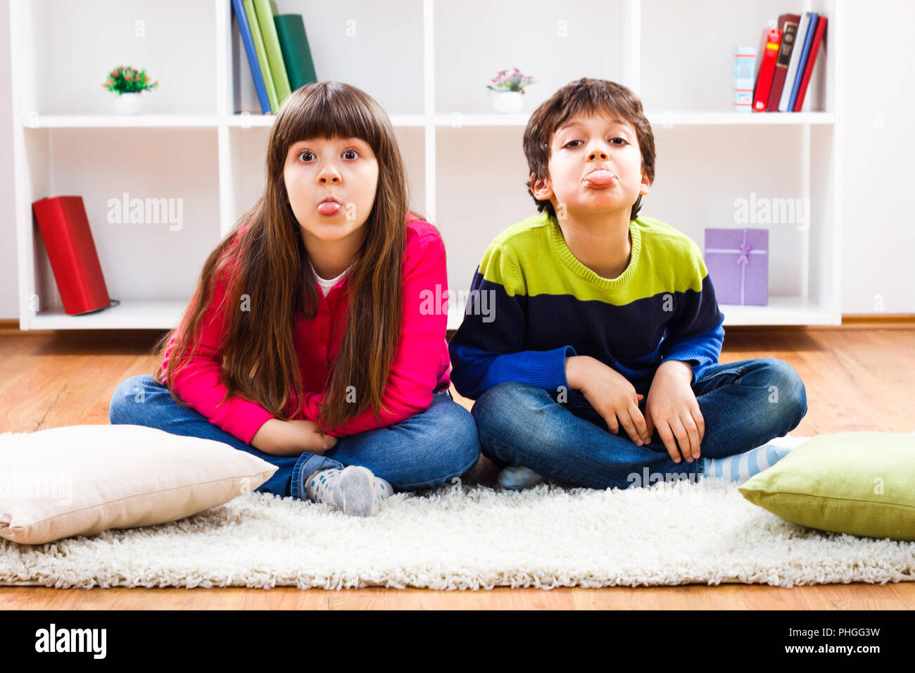 Children sticking out tongue - Stock Image