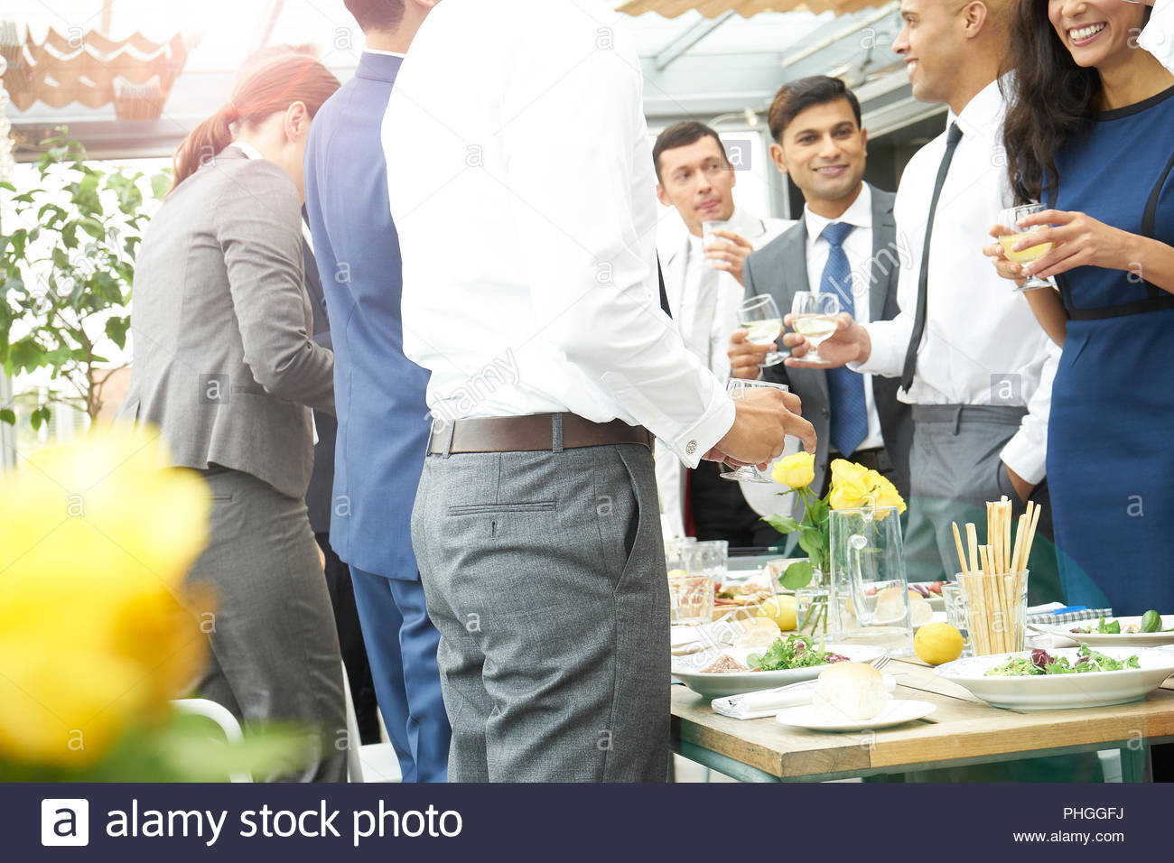 Businesspeople toasting in restaurant - Stock Image