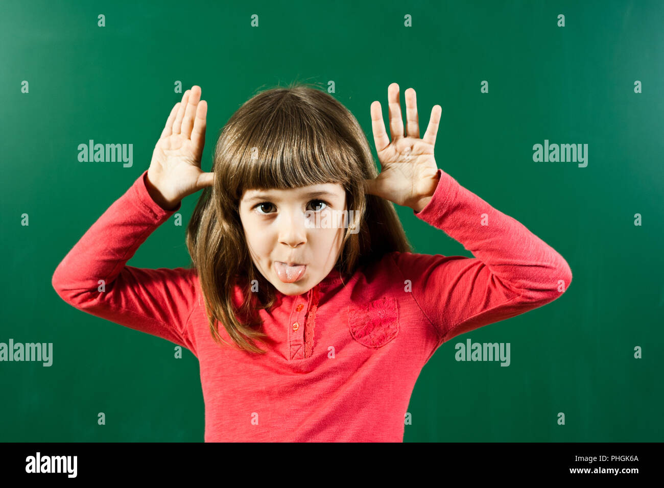 Child sticking Out Tongue - Stock Image