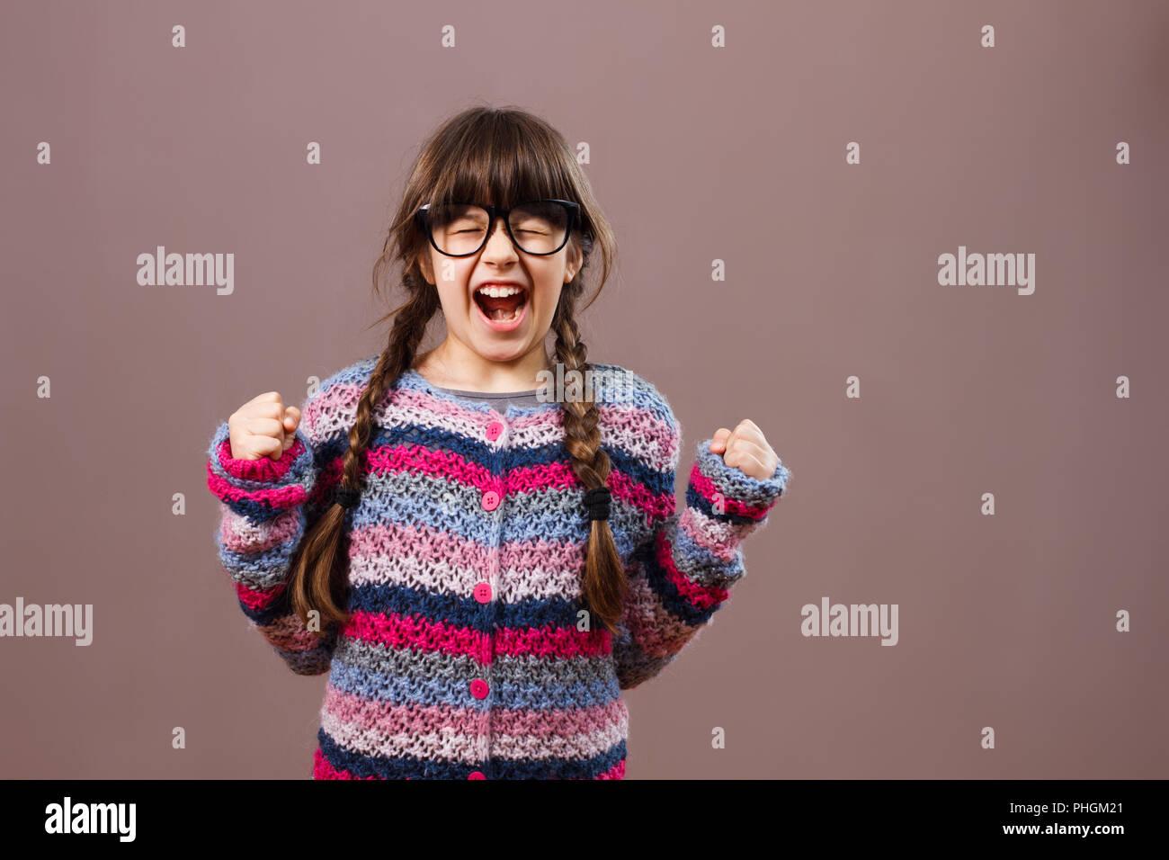 Angry little nerdy girl - Stock Image