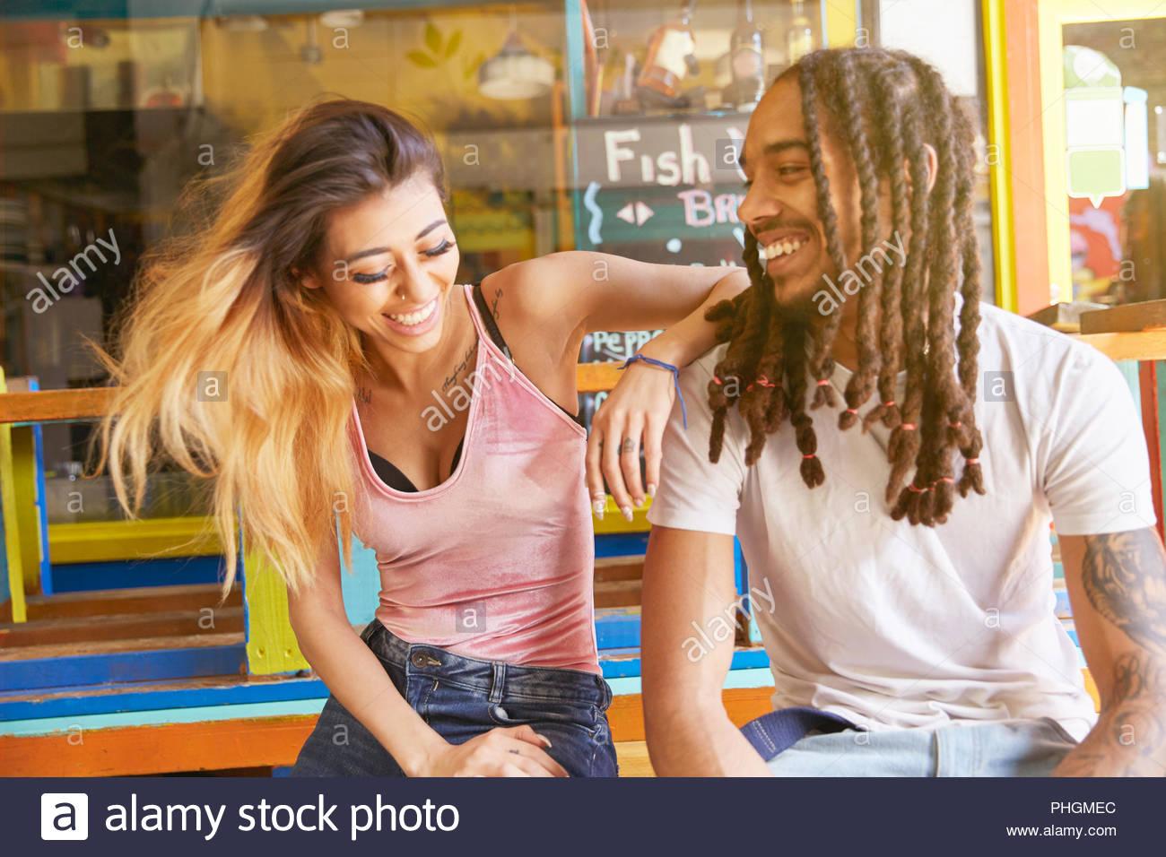 Couple sitting together - Stock Image