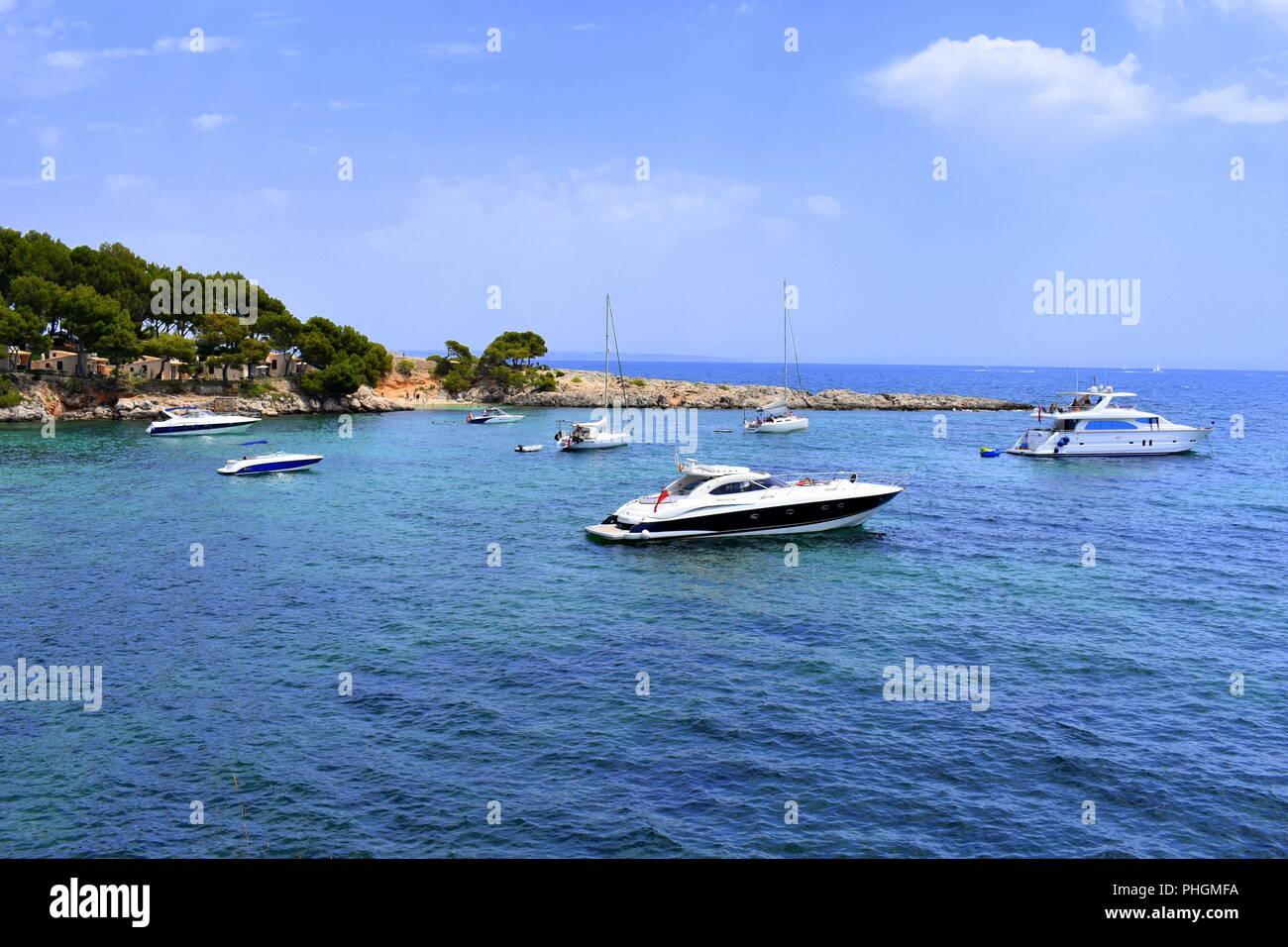 Boats anchored off Punta Negra near Palma Nova, Mallorca, Spain - Stock Image