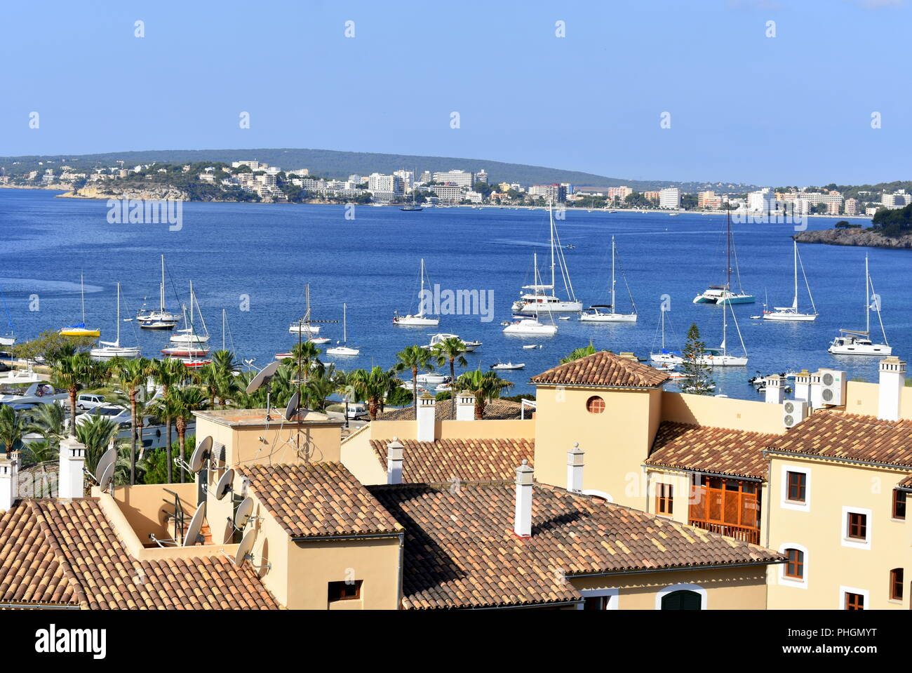 Boats anchored outside Puerto Portals marina and a view towards Palma Nova - Stock Image