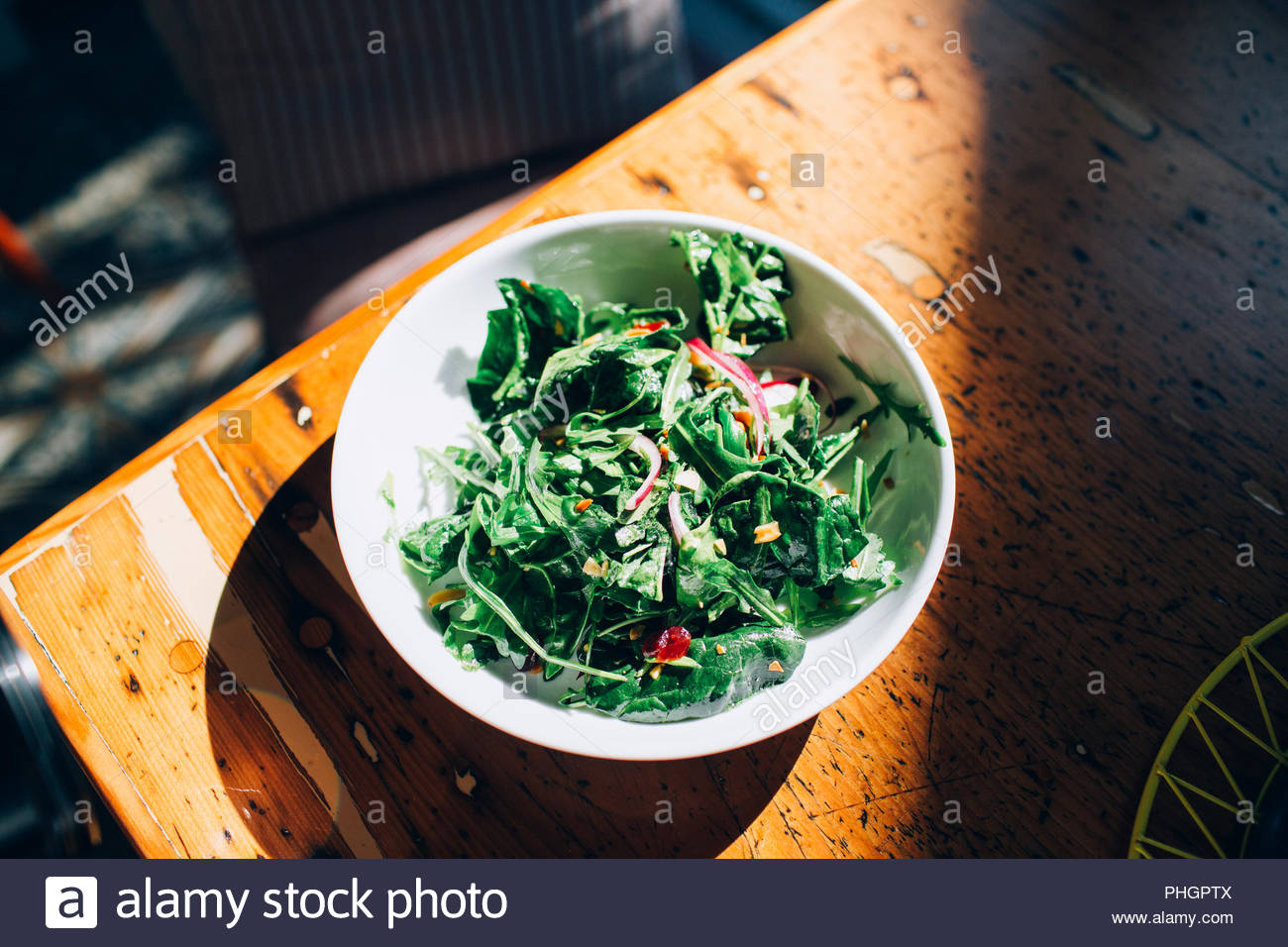 Salad on a wooden tabletop - Stock Image