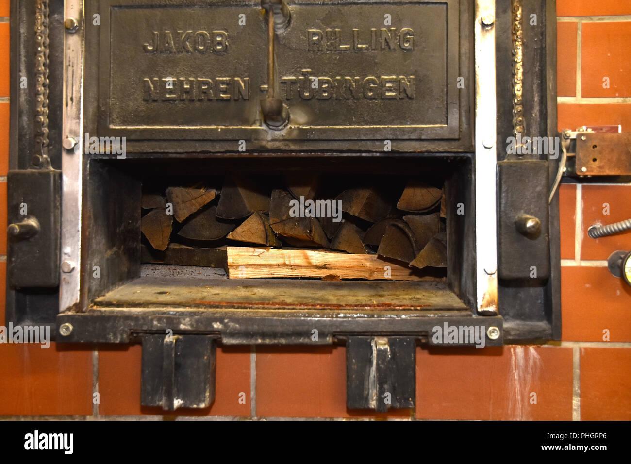 woodstove; baking oven; oven; bakehouse; logs; - Stock Image