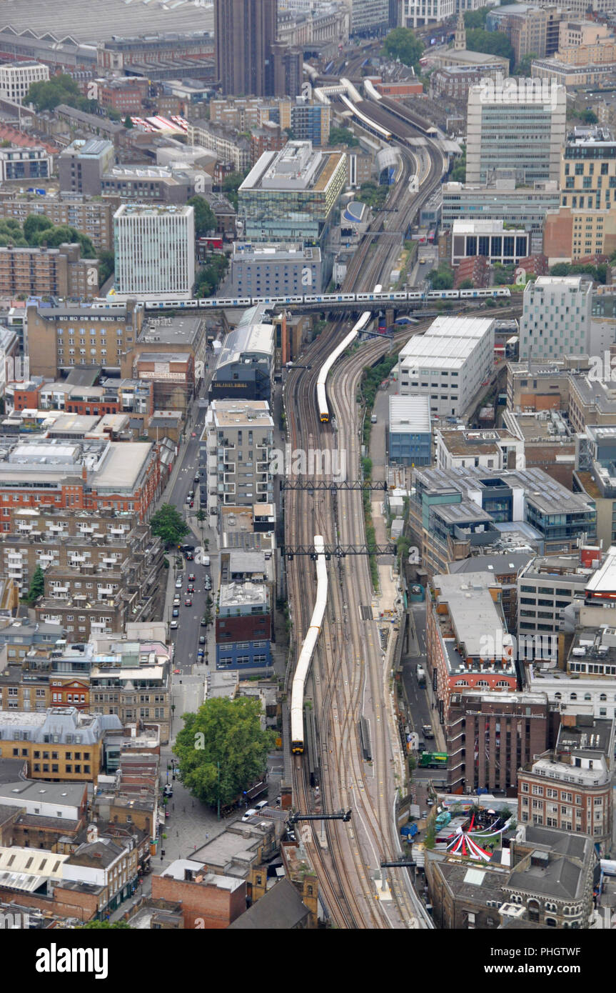 Train lines into London Bridge station, looking West from the Shard Viewing platform - Stock Image
