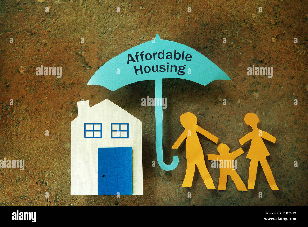 Affordable Housing family umbrella - Stock Image