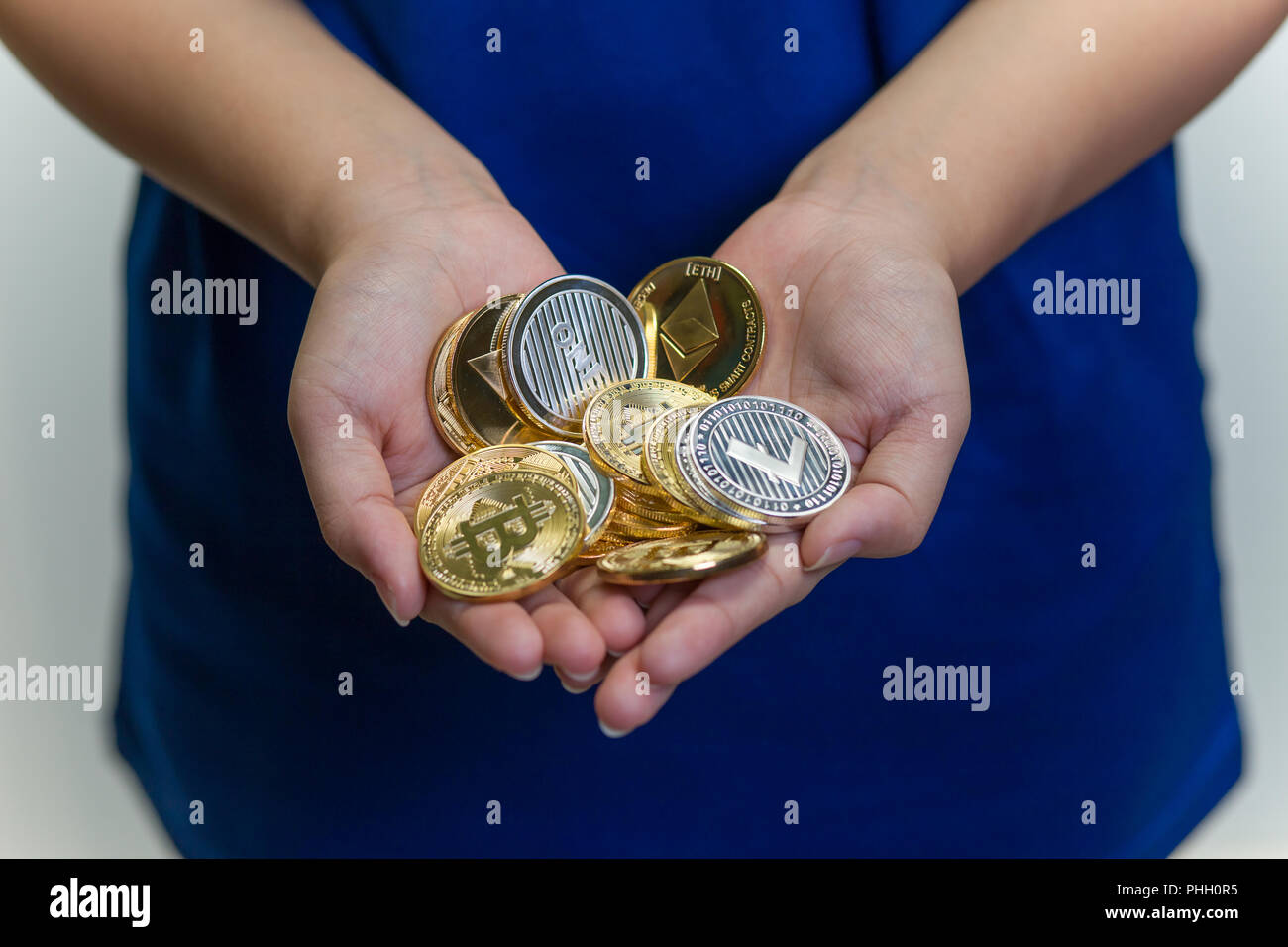 Handful of crypto currencies - Stock Image