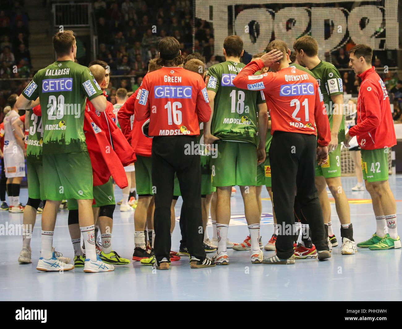 handball team SC Magdeburg at time out - Stock Image