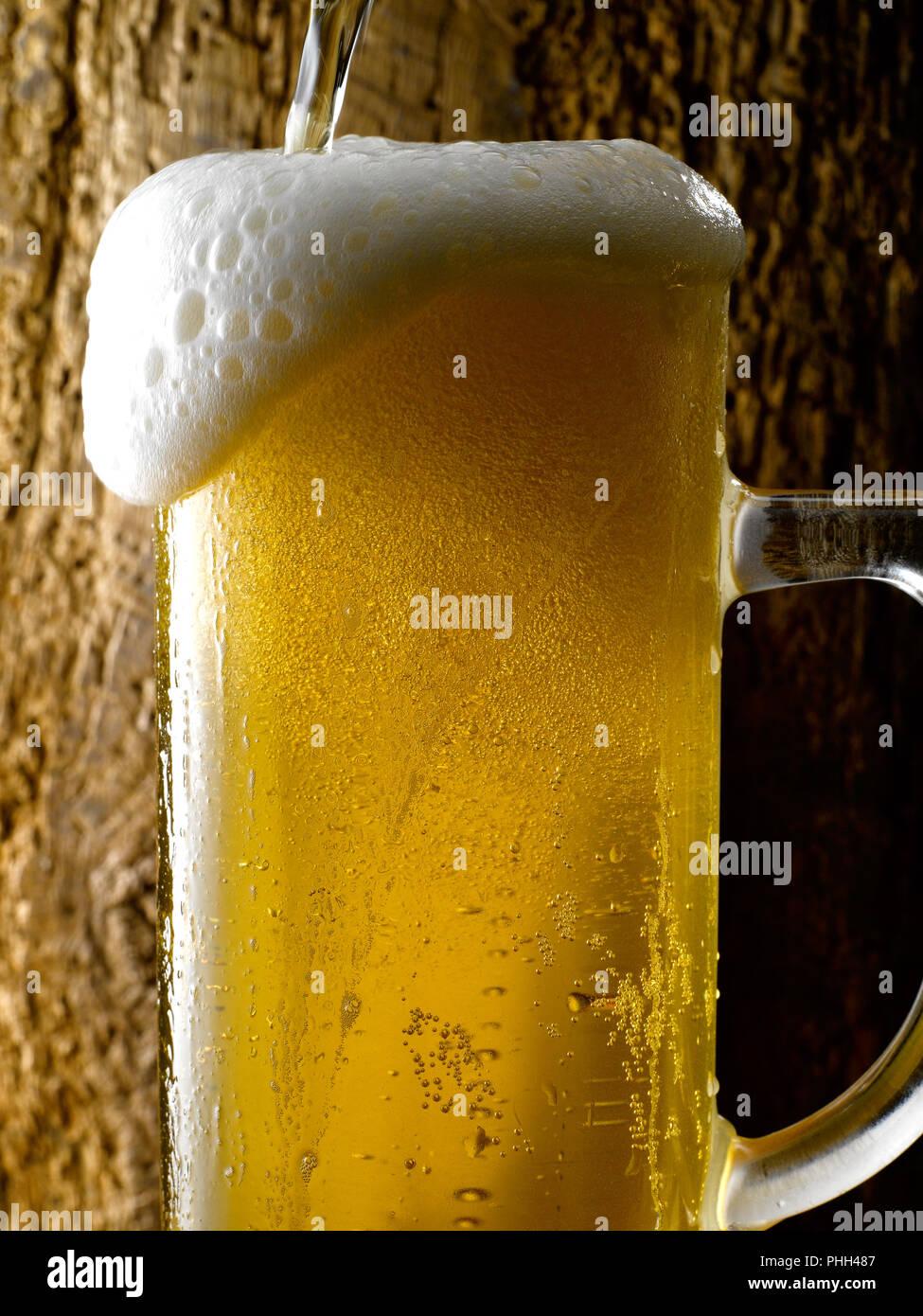 Mug Of Frothy Beer Stock Photo Alamy